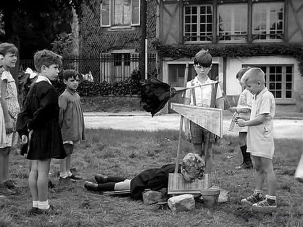1959_children_playing_with_a_toy_guillotine_france.jpg