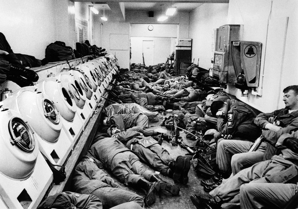 1968_aprilis_u_s_army_soldiers_sleeps_inside_a_laundry_store_in_washington_d_c_with_several_finding_space_on_top_of_the_washing_machines_during_the_mlk_assassination_riots_in_the_nation_s_capital.png