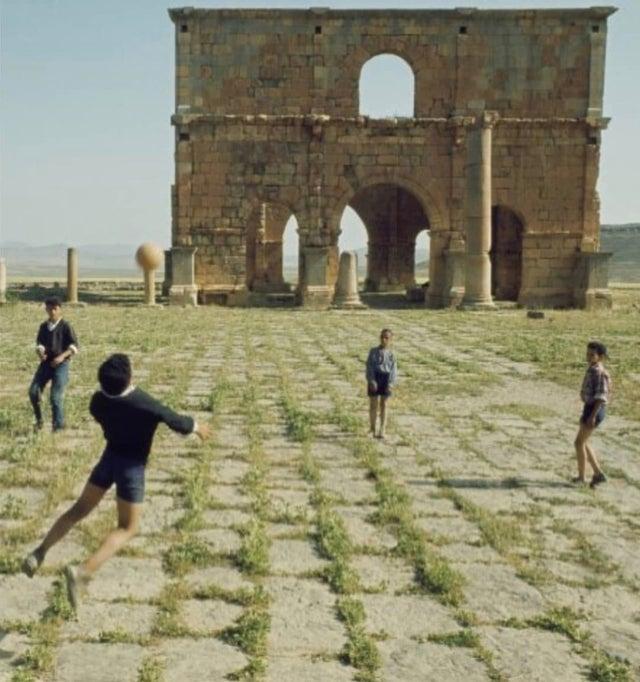 1968_kids_playing_near_roman_ruins_in_batna_algeria.jpg