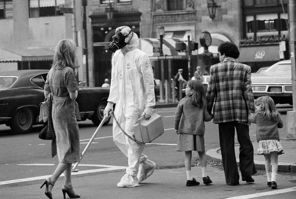 1979_man_crosses_a_manhattan_street_in_a_hazmat_suit_to_publicize_an_upcoming_antinuclear_rally.jpg