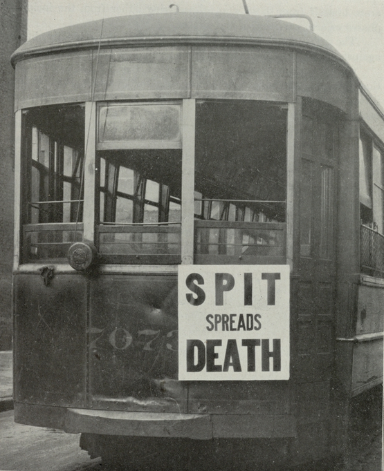 1919_philadelphia_streetcar_with_a_poster_saying_spit_spreads_death_during_the_1918-1919_influenza_pandemic_also_known_as_the_spanish_flu.png