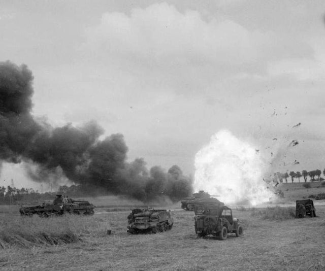 1944_junius_the_british_army_in_the_normandy_campaign_an_ammunition_lorry_of_the_11th_armoured_division_explodes_after_being_hit_by_mortar_fire_during_operation_epsom.jpg