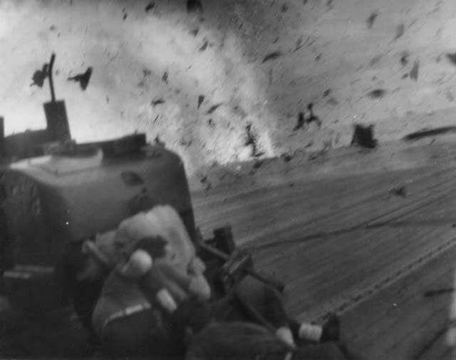 1944_oktober_sailors_take_cover_as_a_kamikaze_hits_the_escort_carrier_uss_santee.jpg