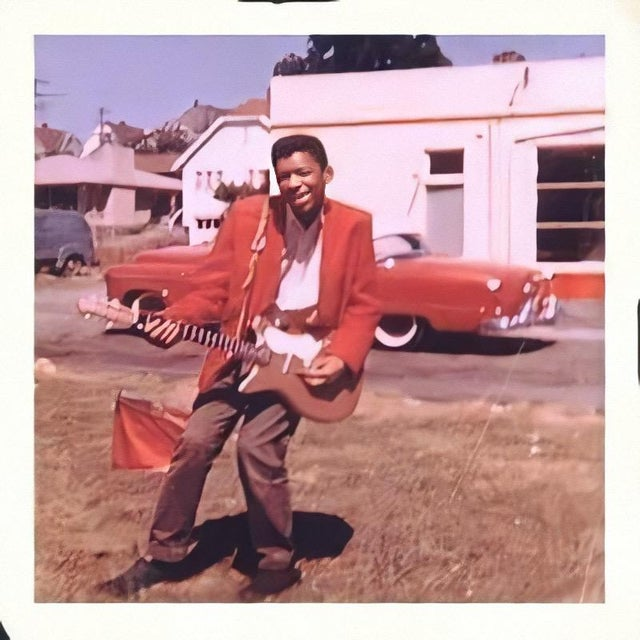 1957_a_young_15_year_old_jimi_hendrix_with_his_first_guitar.jpg