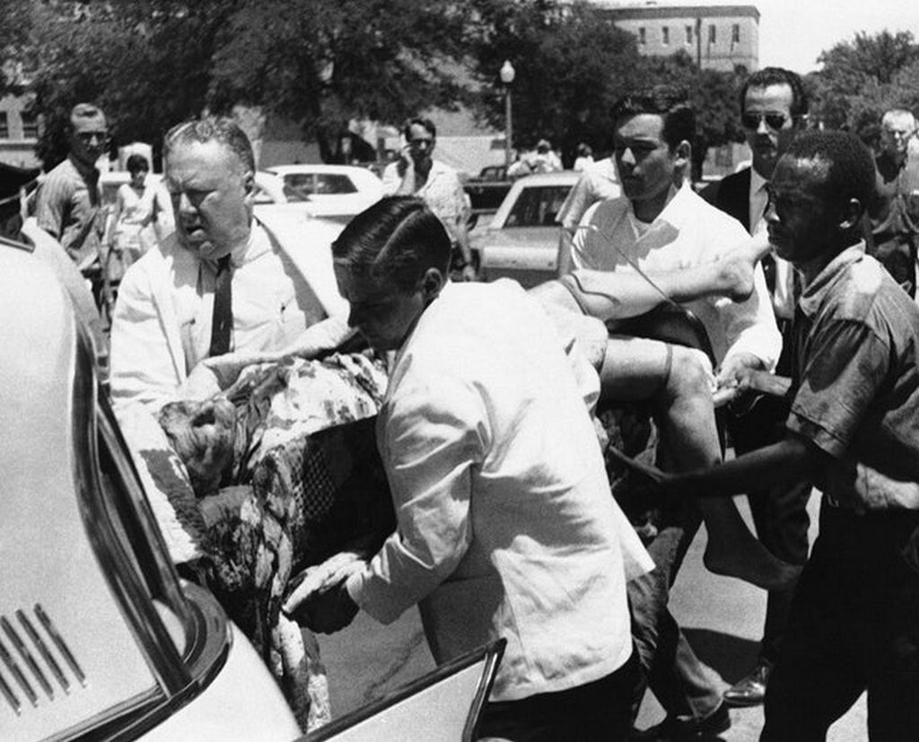 1966_victim_of_charles_whitman_being_put_in_a_ambulance_during_the_university_of_texas_shooting_austin_texas.jpg