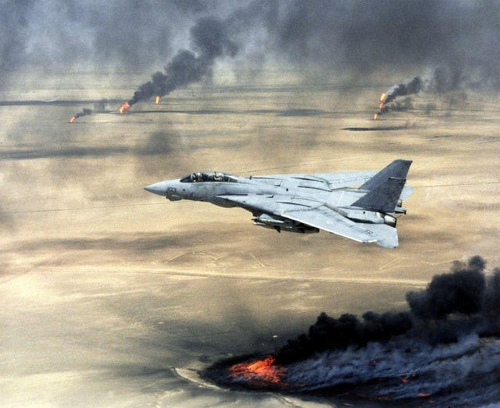 1991_united_states_navy_f-14a_tomcat_fighter_jet_flying_over_burning_kuwaiti_oil_wells_during_operation_desert_storm.jpg
