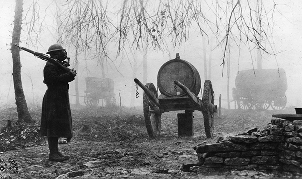 1918_an_american_soldier_stands_guard_during_a_german_gas_attack_in_france.png