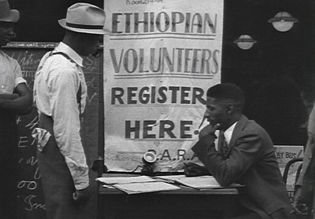 1935_crowds_register_in_harlem_to_defend_ethiopia_upon_hearing_that_africa_s_only_nation_not_conquered_by_european_powers_had_been_invaded_by_mussolini_black_americans_registered_blocked_by_gov.jpg