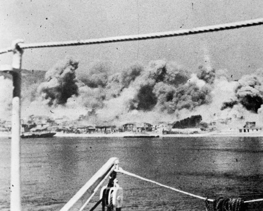 1943_nyara_a_bombing_raid_on_messina_sicily_seen_from_a_ship_moored_in_the_harbour.jpg