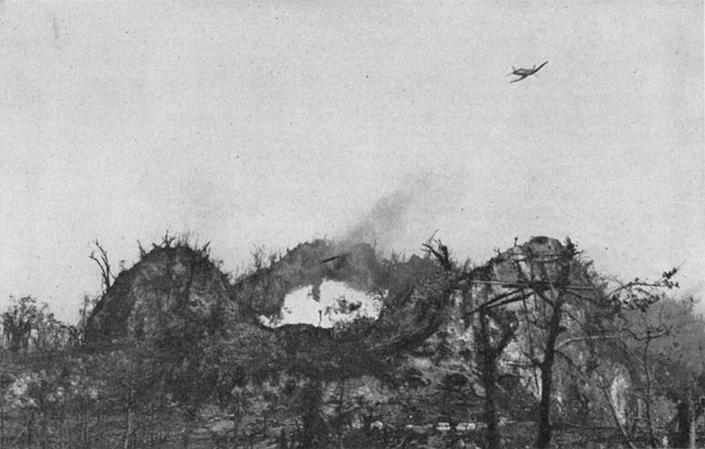 1944_oktobere_u_s_marine_corsair_fighter_drops_napalm_on_japanese_positions_atop_umurbrogol_mountain_peleliu.jpg