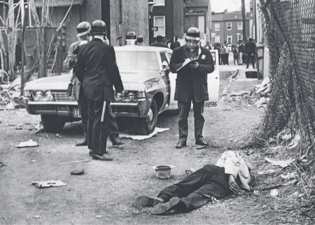 1968_aprilis_the_body_of_a_looter_police_shot_him_to_death_after_he_was_robbed_liquor_store_in_baltimore_during_the_mlk_assassination_riots_across_america.png