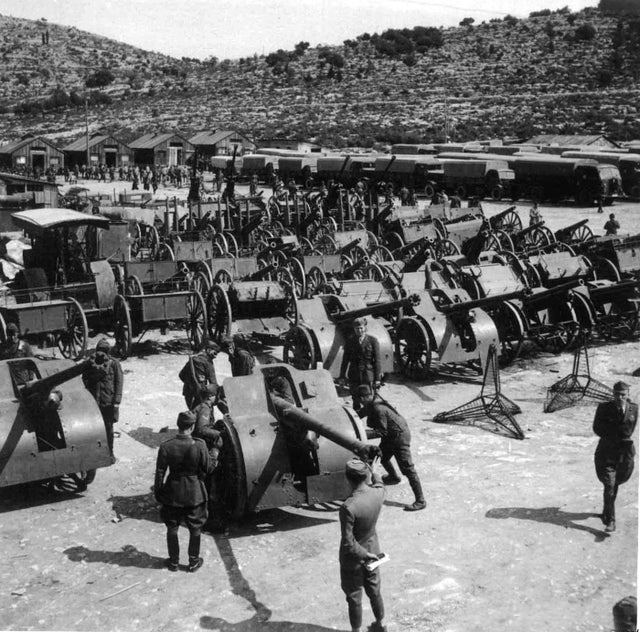 1941_italian_troops_inspecting_captured_artillery_and_equipment_after_the_invasion_of_yugoslavia.jpg