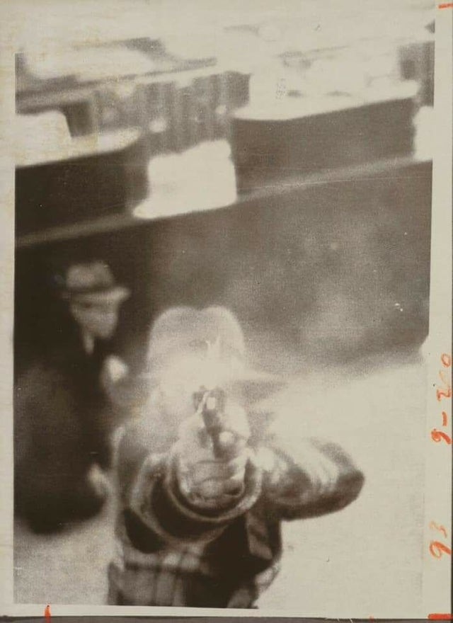1975_a_bank_robber_aiming_at_a_security_camera_cleveland.jpg