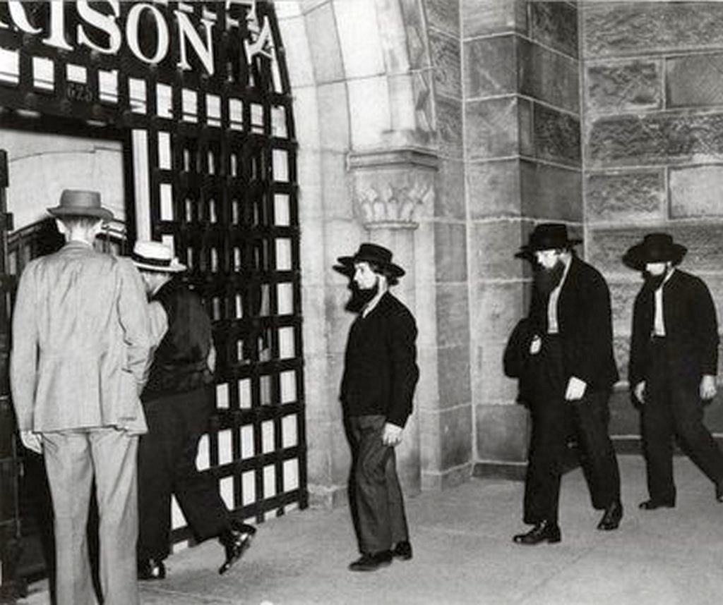 1955_amish_men_being_booked_into_a_pennsylvania_jail_for_refusing_to_send_their_children_to_high_school.jpg