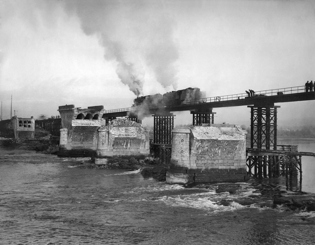 1945_a_train_tests_a_new_temporary_bridge_over_the_loire_in_nantes_france_after_the_previous_bridge_was_destroyed_by_aerial_bombardment.jpg