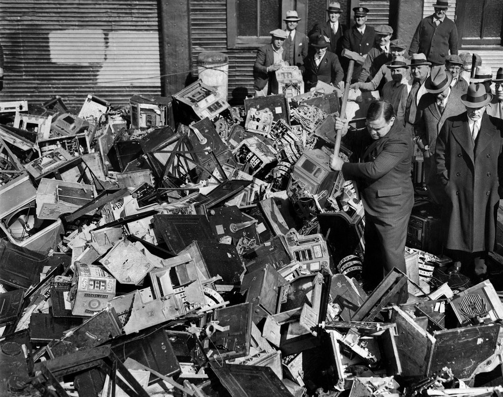 1938_mayor_fiorella_la_guardia_applied_a_sledgehammer_to_hundreds_of_slot_machines_as_part_of_a_continuing_effort_to_curb_gambling_and_guns.jpg