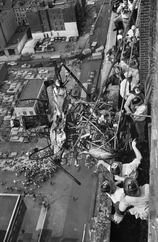 1955_a_crowd_gathered_to_watch_as_workers_pulled_the_burned_wreckage_of_a_helicopter_from_a_16th-floor_ledge_into_which_it_had_crashed_two_people_the_pilot_and_a_port_authority_photographe.jpg
