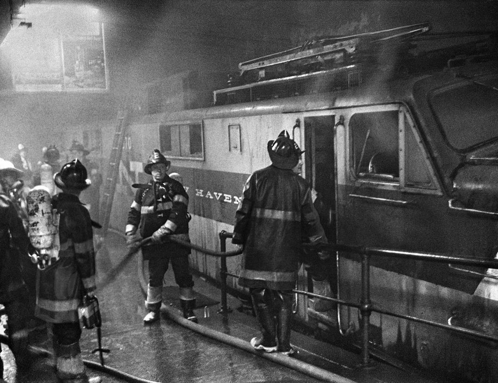 1967_firemen_at_the_scene_a_fire_on_a_track_at_grand_central_terminal_where_a_fire_on_a_train.jpg