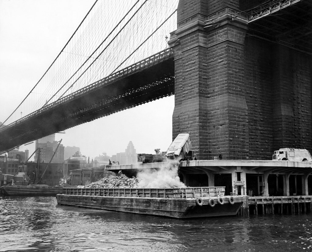 1949_garbage_was_dumped_onto_a_scow_at_the_base_of_the_brooklyn_bridge_on_its_way_to_staten_island_where_city_landfill.jpg