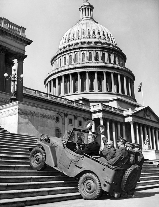 1941_on_the_capitol_steps_senator_james_m_mead_of_new_york_and_representative_j_parnell_thomas_of_new_jersey_demonstrated_the_maneuverability_of_the_army_s_new_midget_scout_cars.jpg