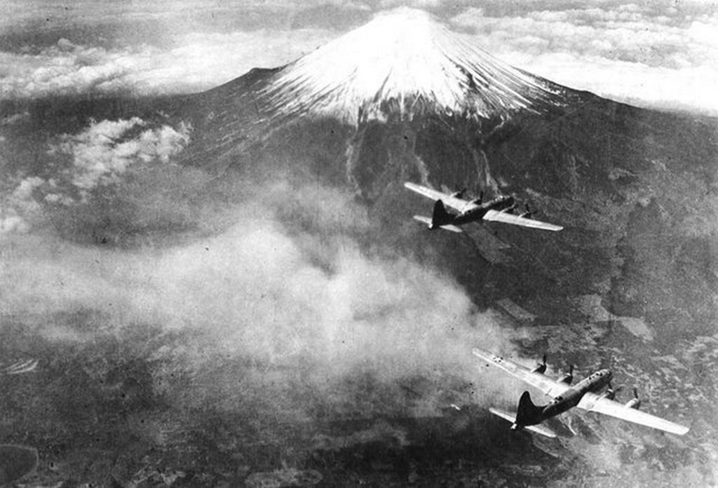 1945_a_formation_of_boeing_b-29_superfortresses_of_the_73rd_bomb_wing_fly_over_mt_fuji_japan.jpg