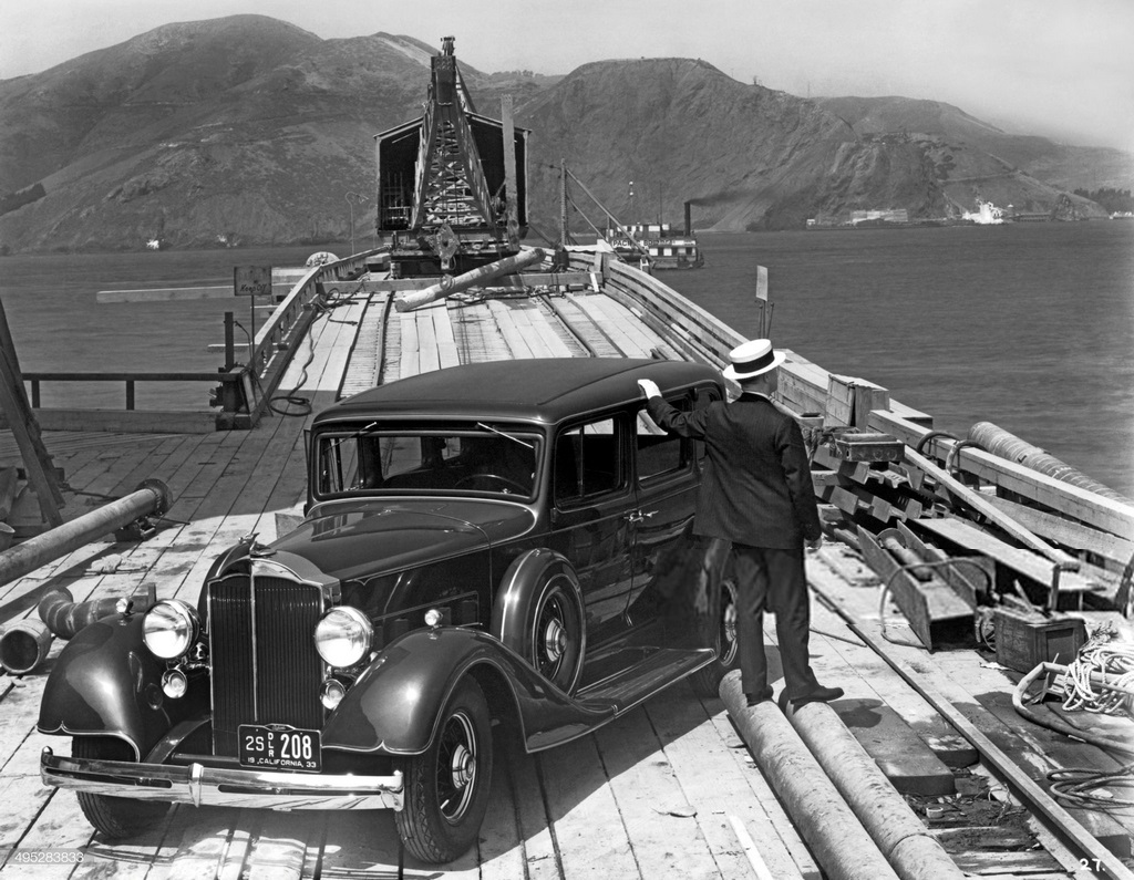 1933_a_man_with_a_1933_packard_on_the_trestle_to_the_south_tower_during_the_beginning_of_the_construction_of_the_golden_gate_bridge_san_francisco.jpg