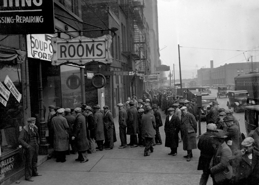 1935_a_group_of_men_line_up_outside_a_chicago_soup_kitchen_opened_by_al_capone.jpg