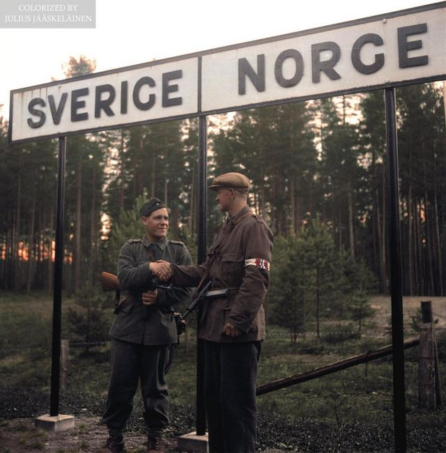 1945_a_swedish_soldier_and_norwegian_resistance_member_shake_hands_at_the_border_celebrating_the_end_of_german_occupation_in_norway.jpg