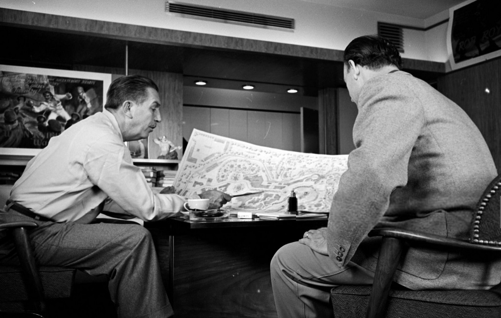 1953_walt_disney_and_one_of_his_artists_john_hench_in_walt_s_burbank_office_discussing_plans_for_disneyland.jpg