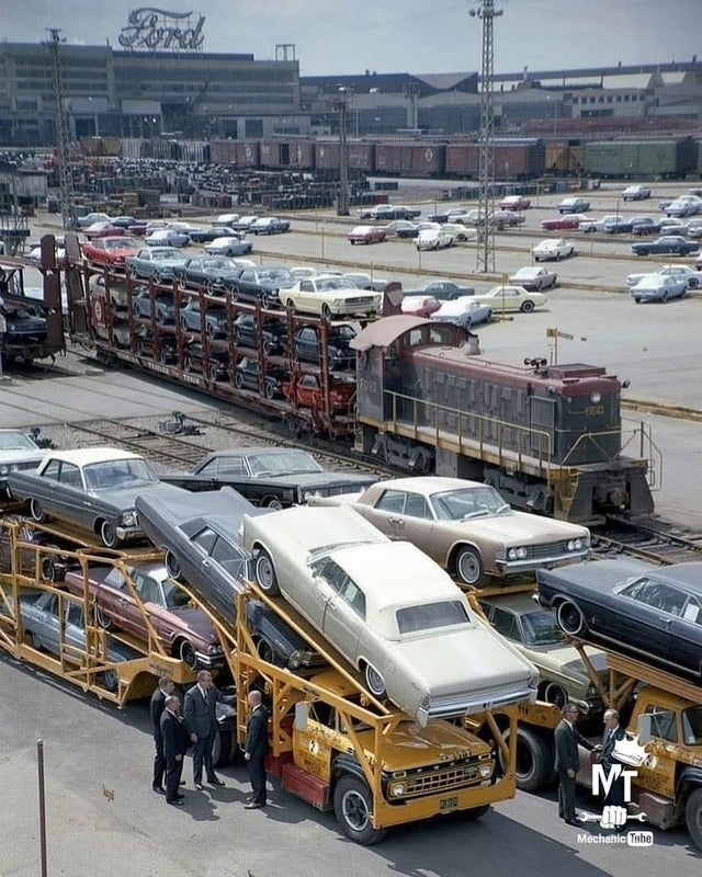 1965_several_mustangs_loaded_on_a_train_car_outside_of_the_dearborn_assembly_plant_part_of_ford_s_river_rouge_complex.jpg