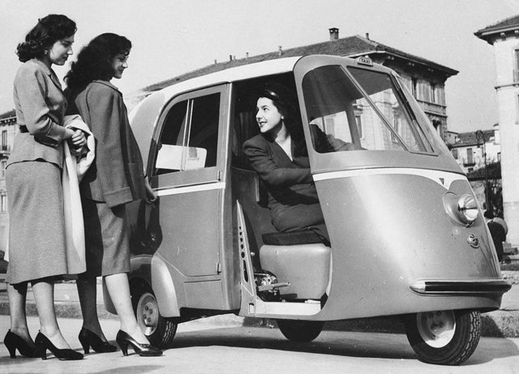 1952_two_women_hailing_a_vespa_taxi-scooter_a_new_type_of_taxi_built_for_two_passengers_in_milan2.jpg