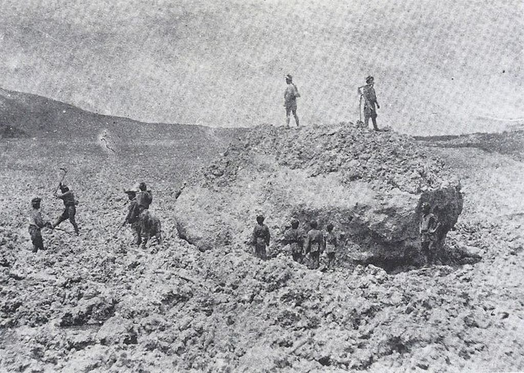 1888_japanese_villagers_stand_amidst_a_huge_boulder_left_from_the_collapse_of_mt_bandai_whose_eruption_had_just_erased_multiple_hamlets_and_reshaped_the_local_topography_fukushima.jpg