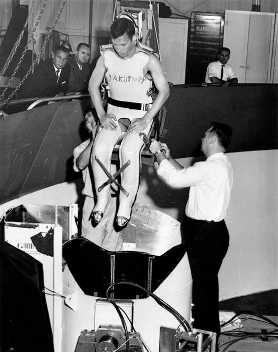 1964_john_zakutney_one_of_11_deaf_nasa_volunteers_whose_deafness_made_them_immune_to_motion_sickness_being_lowered_into_a_centrifuge_tank_to_study_the_effects_of_space_flight.jpg