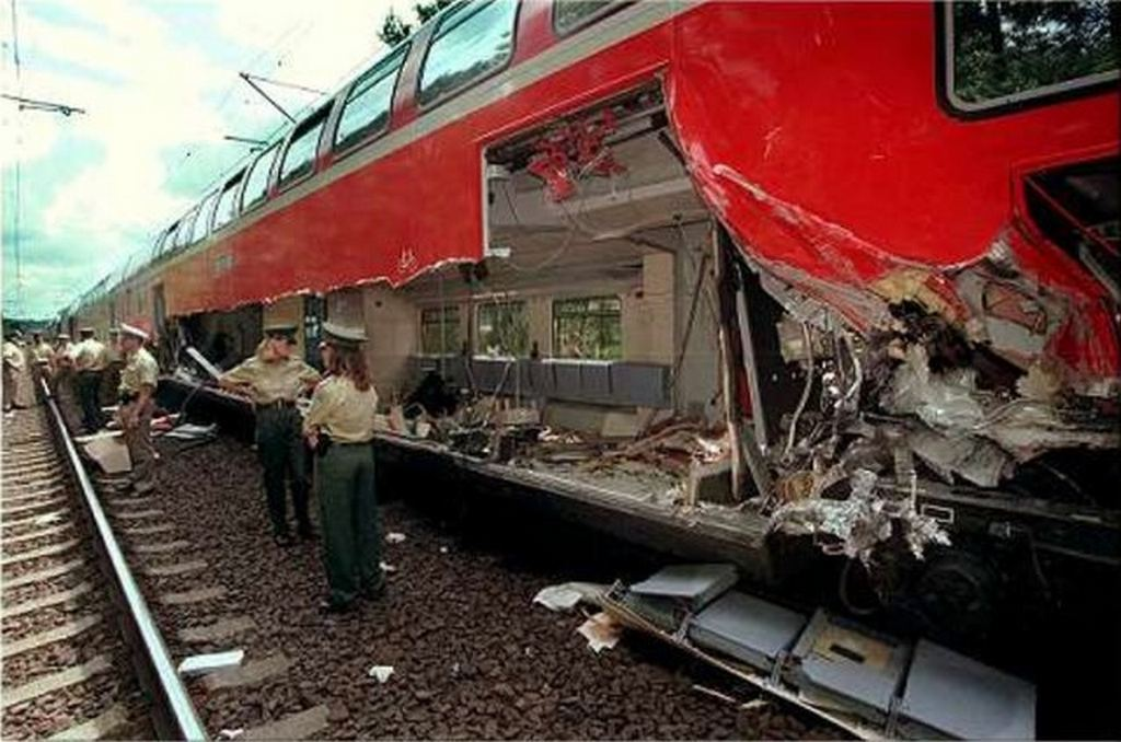 1997_neustadt_train_disaster_safety_ropes_on_a_freight_car_give_out_dropping_several_six_ton_pipes_with_one_slicing_an_oncoming_train_open_six_people_died.jpg