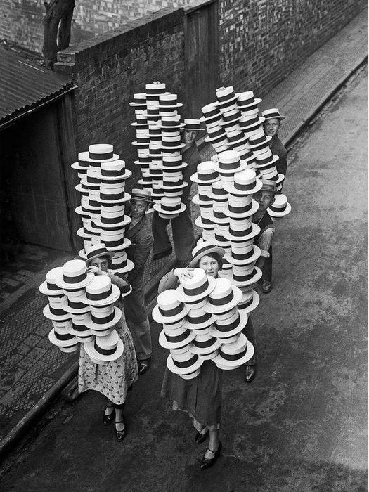 1933_straw_hats_made_by_messrs_olney_s_of_luton_bedfordshire_being_carried_to_the_packing_rooms.jpg