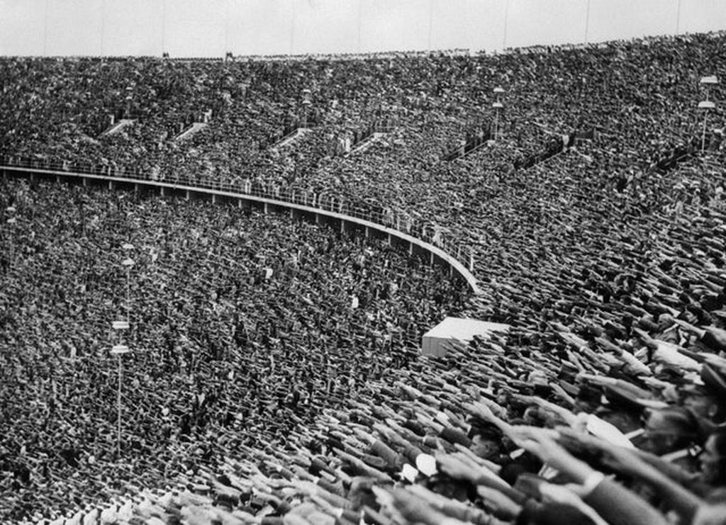 1936_the_huge_crowd_give_the_nazi_salute_in_berlin_s_olympic_stadium_as_chancellor_adolf_hitler_declares_the_1936_summer_olympic_games_open.jpg