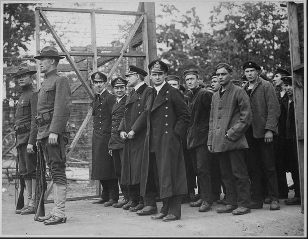 1918_officers_and_crew_of_the_german_submarine_u_58_captured_by_the_u_s_s_fanning_entering_the_war_prison_camp_at_fort_mcpherson_georgia.jpg