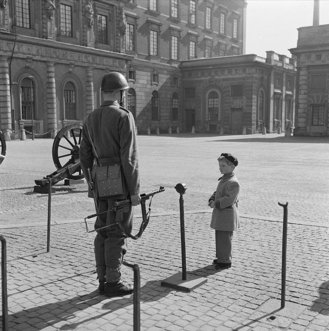1952_crown_prince_carl_gustaf_currently_king_carl_xvi_gustaf_of_sweden_inspecting_a_soldier_at_the_royal_palace_stockholm_cr.jpg