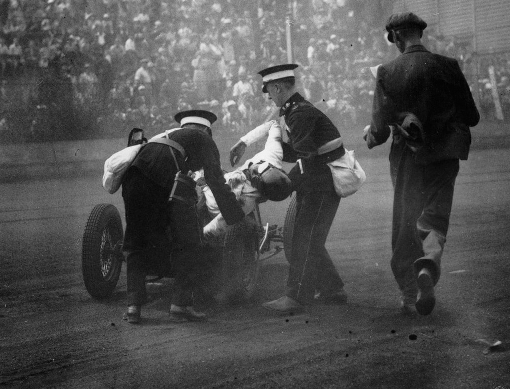 1935_paramedics_lifting_the_badly_injured_driver_after_an_accident_out_of_the_racing_car_london_england.jpg