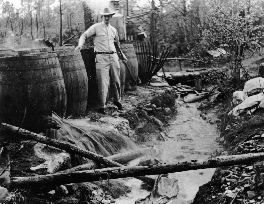 1950_barrels_of_illegal_moonshine_liquor_being_destroyed_by_american_revenue_agents.jpg