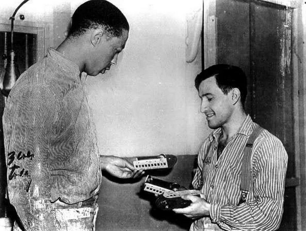 1939_joe_arridy_giving_his_toy_train_to_another_inmate_before_he_is_taken_to_the_gas_chamber.jpg