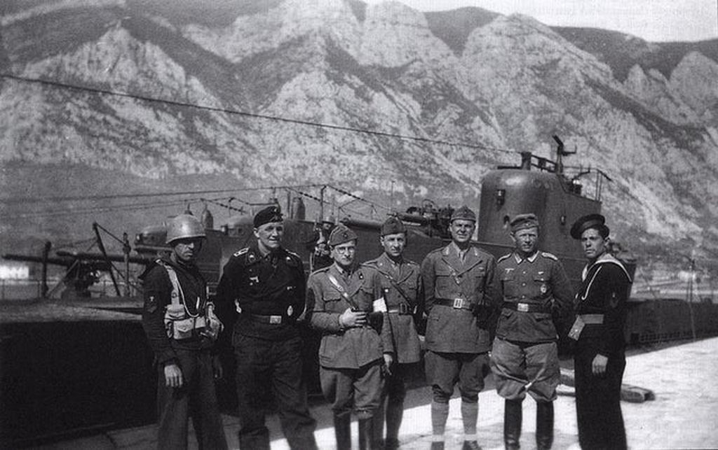 1941_italian_and_german_soldiers_and_sailors_standing_in_front_of_captured_yugoslav_submarines_hrabri_in_the_foreground_kotor.jpg