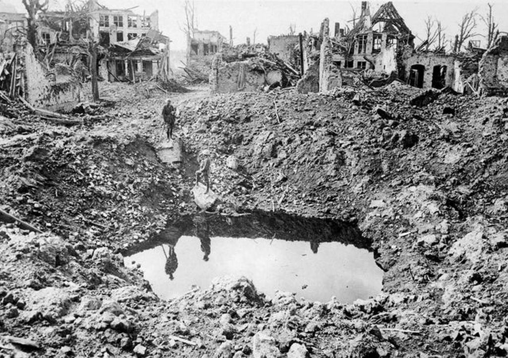 1917_wwi_a_gigantic_shell_crater_75_yards_in_circumference_ypres_belgium.jpg