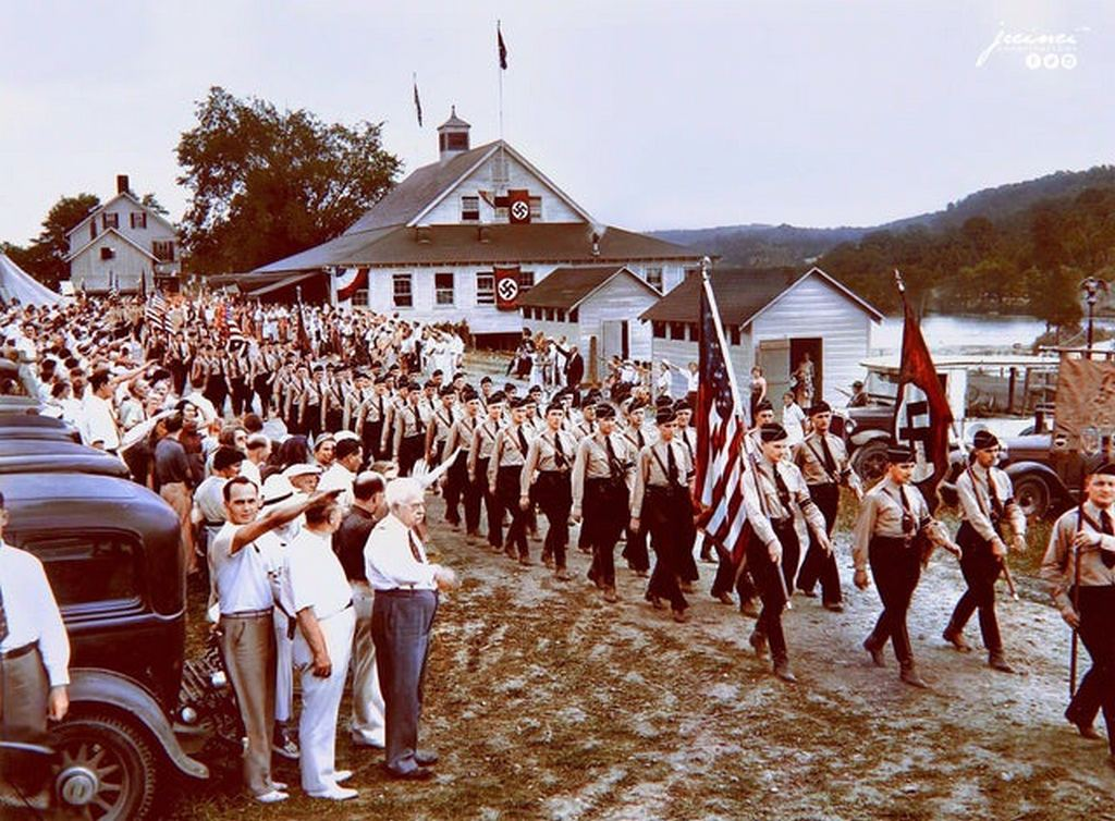 1937_nearly_1_000_uniformed_men_wearing_swastika_arm_bands_and_carrying_nazi_banners_parade_past_a_reviewing_stand_in_new_jersey_on_july_18_1937.jpg