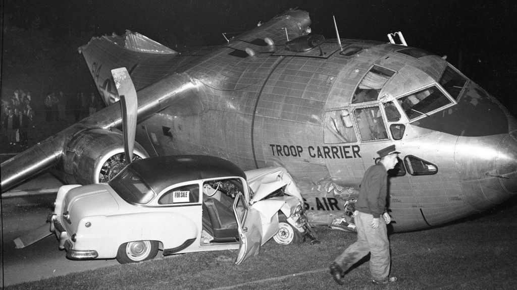 1958_fairchild_c-123b_emergency_landing_on_southern_state_parkway_at_night_after_ran_out_of_fuel_collided_with_three_cars_killing_one_driver_six_others_injured.jpg