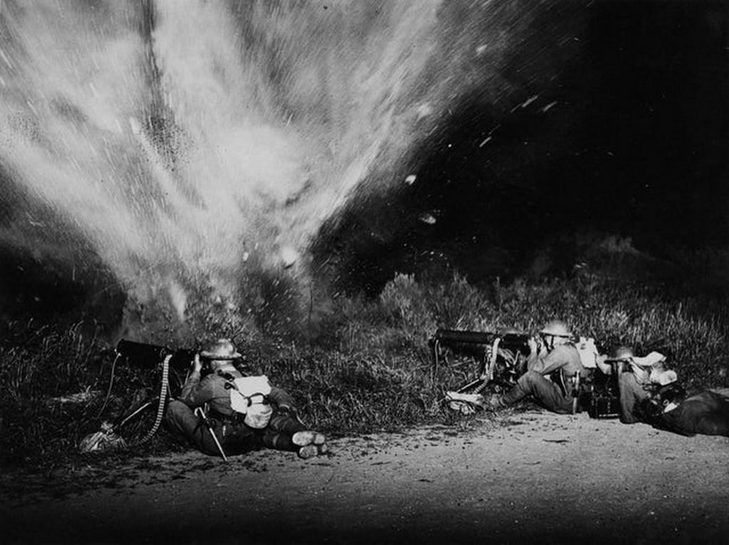 1917_a_mine_exploding_in_front_of_two_british_machine_gun_crews_western_front_photo_taken_by_john_warwick_brooke.jpg