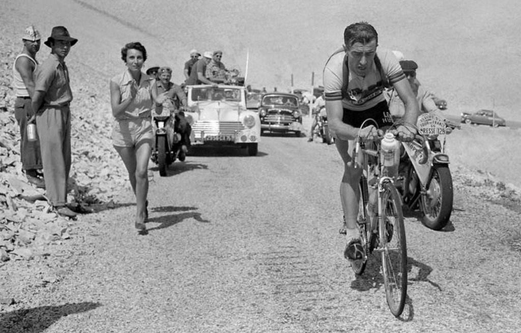 1955_french_louison_bobet_cheered_on_by_his_wife_christiane_climbs_the_mont_ventoux_on_his_way_to_winning_the_11th_stage_of_the_tour_de_france_between_marseille_and_avignon.jpeg