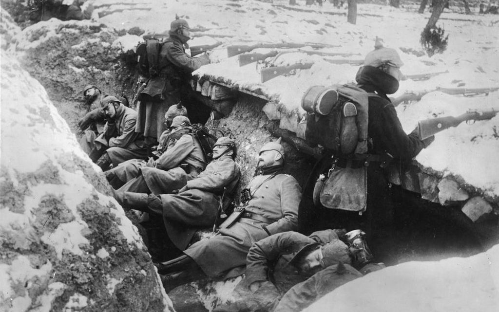 1914_german_soldiers_sleeping_in_snowy_trenches_as_two_guards_stand_with_their_rifles_poised_near_the_aisne_river_valley_france.jpg