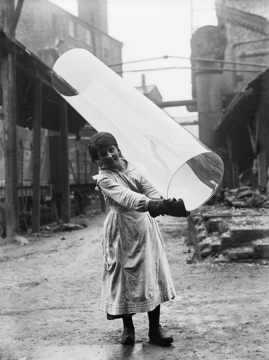 1918_a_female_glass_worker_carrying_a_tube_of_rolled_glass_at_pilkington_glass_ltd_of_st_helen_s_lancashire.jpg