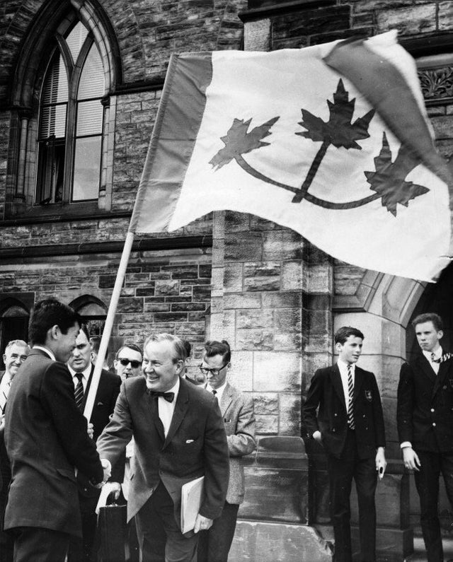 1964_prime_minister_lester_b_pearson_shaking_hands_with_university_student_who_presented_his_proposal_for_the_great_flag_debate_ottawa.jpg